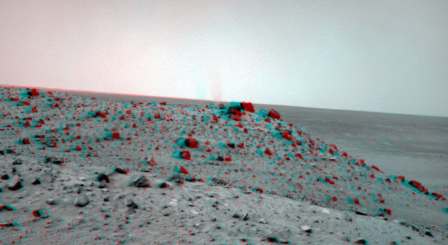 The navigation camera on NASA's Mars Exploration Rover Spirit caught this stereo view of a dust devil during the 1,913th Martian day