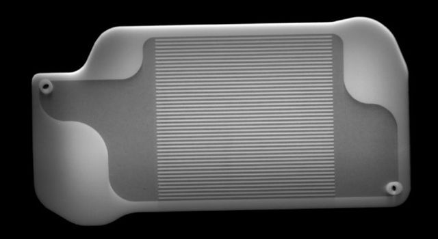 This X-ray image shows the inside of a 3D-printed part inside of Perseverance's MOXIE instrument