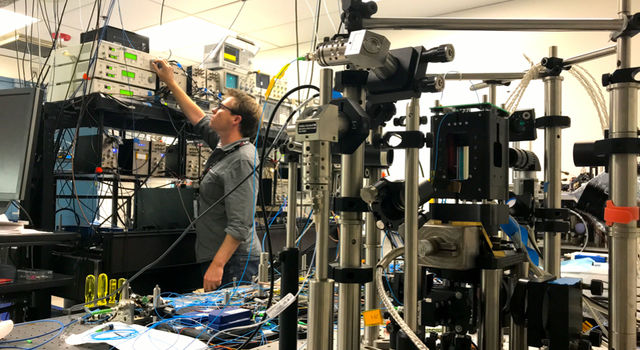 Cold Atom Laboratory (CAL) physicist David Aveline works in the CAL test bed