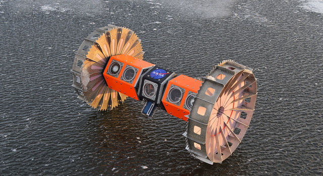 An orange robot with two spikey wheels on either side of a hexagonal axle