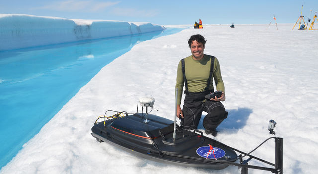 JPL scientist Alberto Behar in Greenland with the robotic boat he designed.