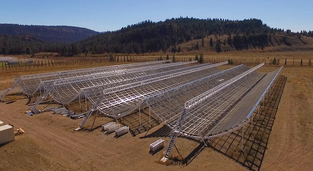 This aerial view shows the Canadian Hydrogen Intensity Mapping Experiment (CHIME), a radio telescope located at Dominion Radio Astrophysical Observatory in British Columbia