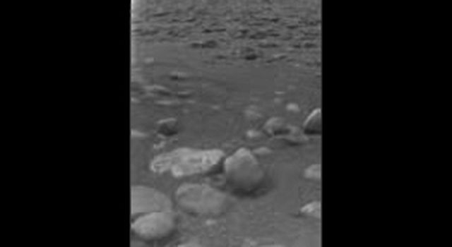 The surface of Titan with ice blocks strewn around