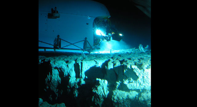 A submersible rests on the seafloor above a region of active serpentinization near the Lost City hydrothermal vent field in the mid-Atlantic Ocean.
