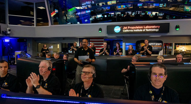 Spitzer Project Scientist Joseph Hunt stands in Mission Control