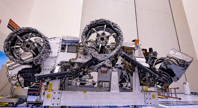 Three of the six flight wheels that will travel to Mars can be seen attached to NASA's Perseverance rover