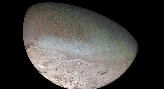 This global color mosaic of Neptune's moon Triton was taken in 1989 by Voyager 2