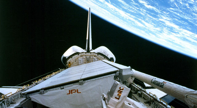 The Space Shuttle Endeavor flying upside-down with SIR-C/X-SAR