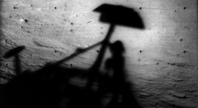 Image of Surveyor 1's shadow against the lunar surface in the late lunar afternoon, with the horizon at the upper right.