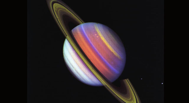 This psychedelic false-color view of Saturn from Voyager 2 reveals structure in the planet's banded clouds.