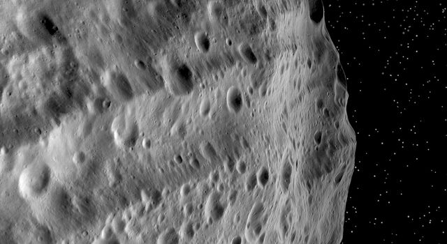 This image from NASA's Dawn mission shows huge grooves on Vesta that were the result of large impacts.