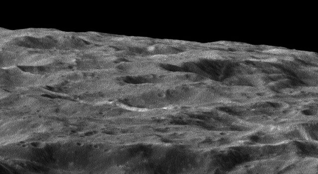 Dione's Impact-Battered Icescape