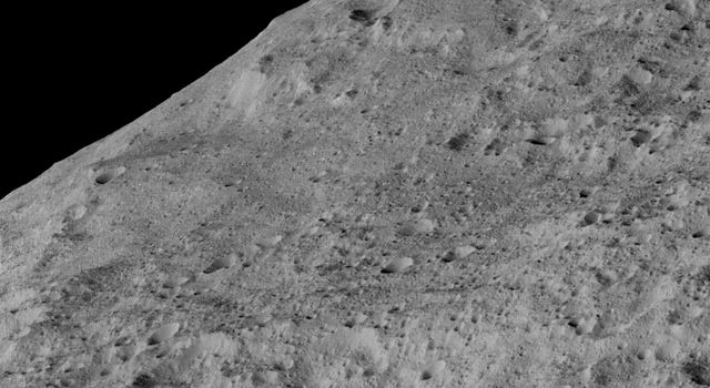 Image shows an area in the southern mid-latitudes of the dwarf planet