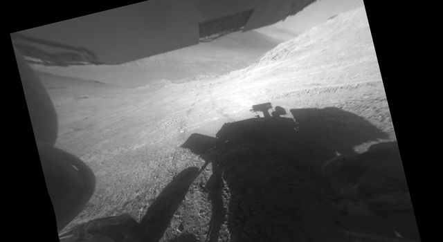 Opportunity's Shadow and Wheel Tracks on Slope