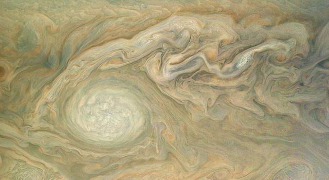 This view of Jupiter, taken by the JunoCam imager of NASA's Juno spacecraft, highlights Oval BA -- a massive storm known as the Little Red Spot.