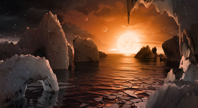 This artist's concept by Tim Pyle allows us to imagine what it would be like to stand on the surface of the exoplanet TRAPPIST-1f.
