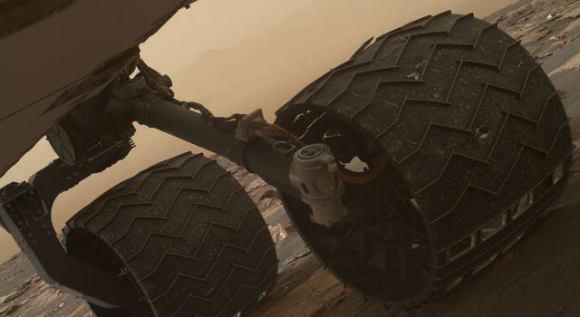 Two of the raised treads, called grousers, on the left middle wheel of NASA's Curiosity Mars rover broke