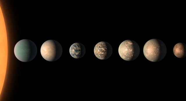This artist's concept shows what the TRAPPIST-1 planetary system may look like