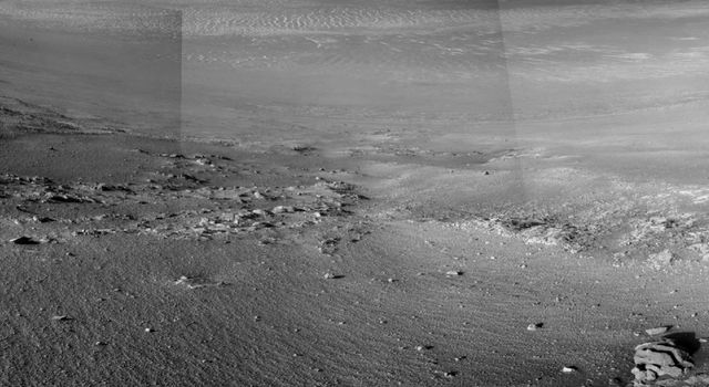 The Opportunity rover reveals textured rows in the martian soil.