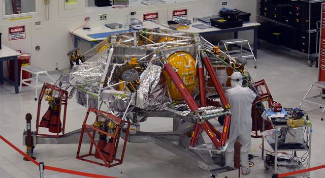 A technician works on the descent stage for NASA's Mars 2020 mission
