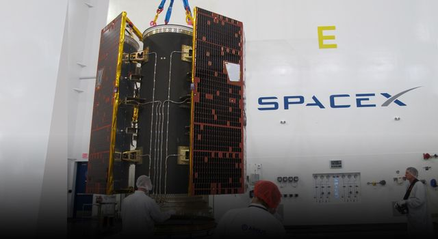 Technicians inspect the twin GRACE Follow-On satellites