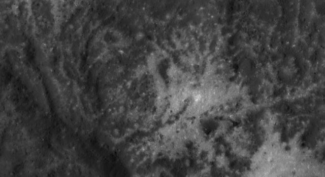 This close-up image of the Vinalia Faculae in Occator Crater was obtained by NASA's Dawn spacecraft on June 14, 2018 from an altitude of about 24 miles (39 kilometers).