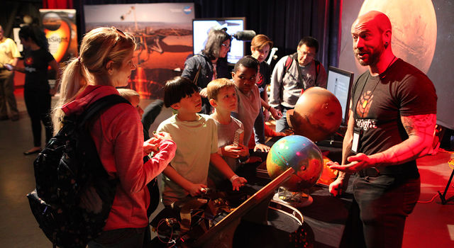Troy Hudson, right, shares the science of NASA's InSight mission with kids at San Francisco's Exploratorium