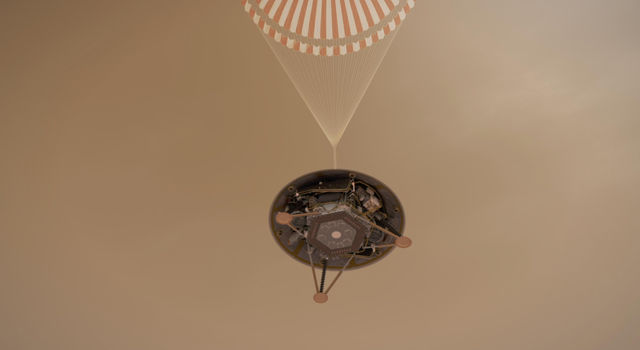 This illustration shows a simulated view of NASA's InSight lander descending on its parachute