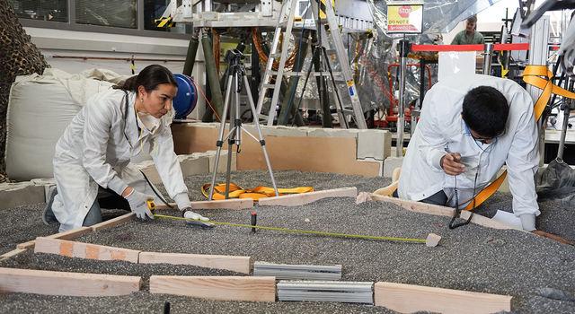 Engineers Marleen Sundgaard (left) and Pranay Mishra measure their test lander's