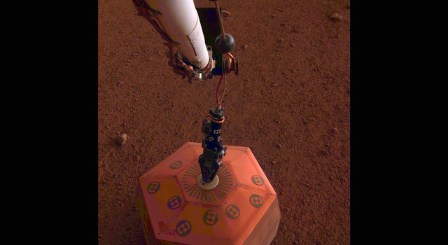 Photo taken by NASA's InSight lander placing its seismometer on Mars