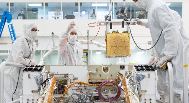 Members of NASA's Mars 2020 project install the Mars Oxygen In-Situ Resource Utilization Experiment