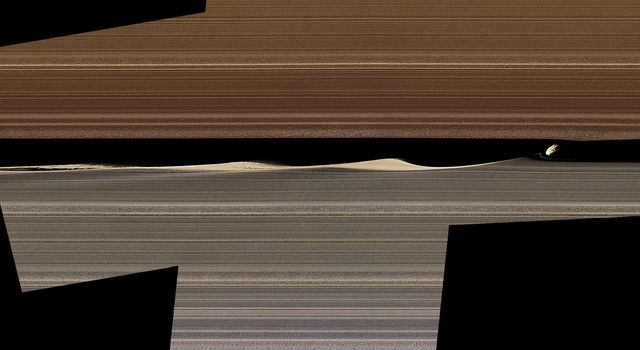 A false-color image mosaic shows Daphnis