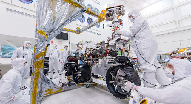 Engineers at JPL install the starboard legs and wheels
