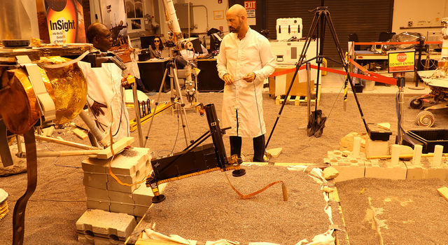 Engineers in a Mars-like test area at NASA's Jet Propulsion Laboratory