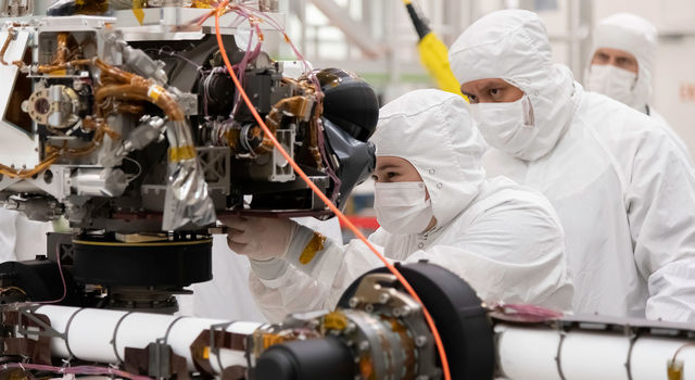 Engineers at JPL install a sensor-filled turret
