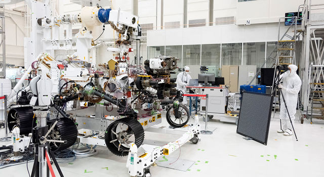 Engineers test cameras on the top of the Mars 2020 rover's mast and front chassis.