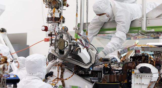 n this August 5, 2019 image, the bit carousel - the heart of sampling and caching subsystem of NASA's Mars 2020 mission -  is attached to the front end of the rover.