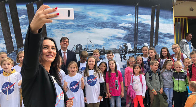 Ruzucic snaps a selfie of the ambassador with local school children.