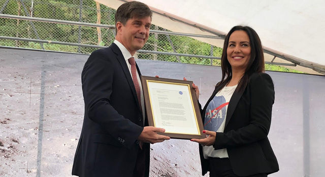 Ambassador to Bosnia and Herzegovina, presents a framed letter to the Snezana Ruzucic, mayor of the Balkan municipality of Jezero