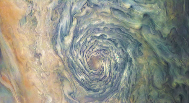 Soft pastels enhance the rich colors of the swirls and storms in Jupiter's clouds