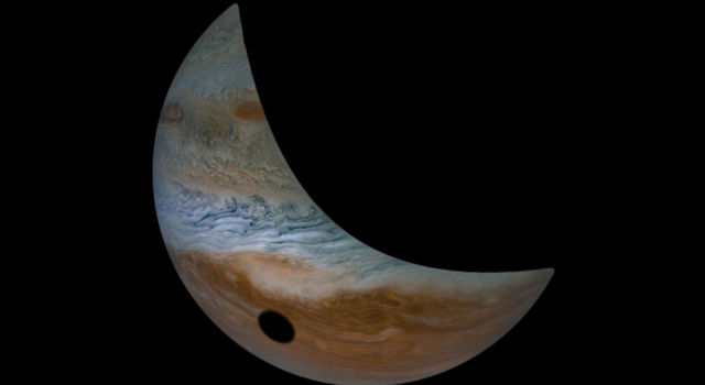 Jupiter's moon Io casts its shadow on Jupiter