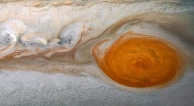 Swirling in Jupiter's atmosphere for hundreds of years, the Great Red Spot is captured in this pair of close-up images from Juno's JunoCam camera