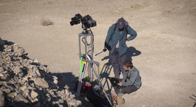 Two members of the field team set up cameras as part of the simulated rover operation