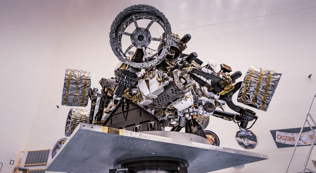 NASA's Perseverance rover can be seen attached to a spin table during a test