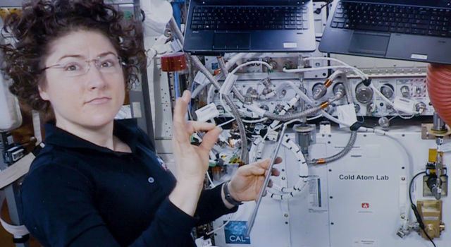 Astronaut Christina Koch assists with a hardware upgrade for NASA's Cold Atom Lab