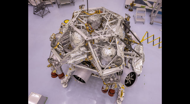 This image of the rocket-powered descent stage sitting on to of NASA's Perseverance rover
