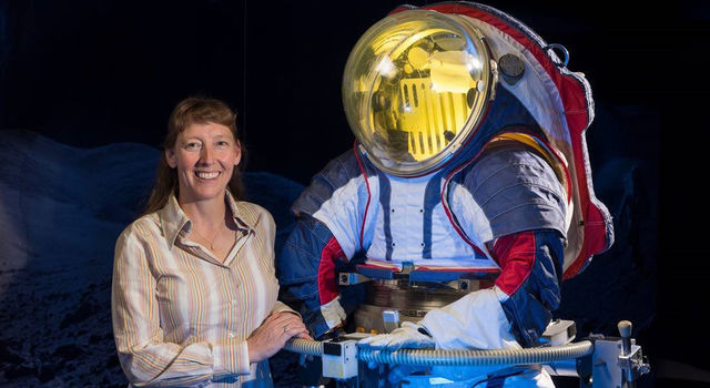 Advanced spacesuit designer Amy Ross of NASA's Johnson Space Center stands with the Z-2, a prototype spacesuit