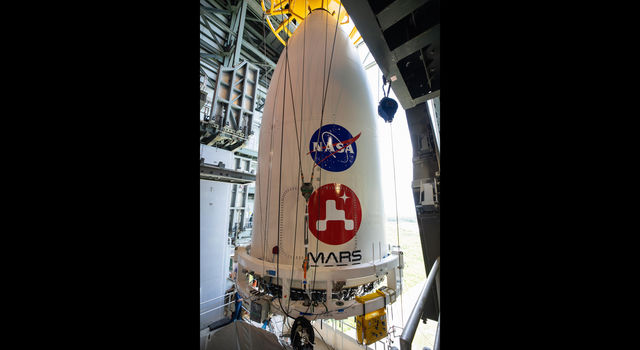 The nose cone containing NASA's Mars 2020 Perseverance rover is maneuvered into place atop its Atlas V rocket
