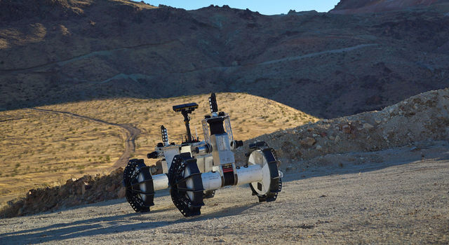 The DuAxel rover is seen here participating in field tests in the Mojave Desert