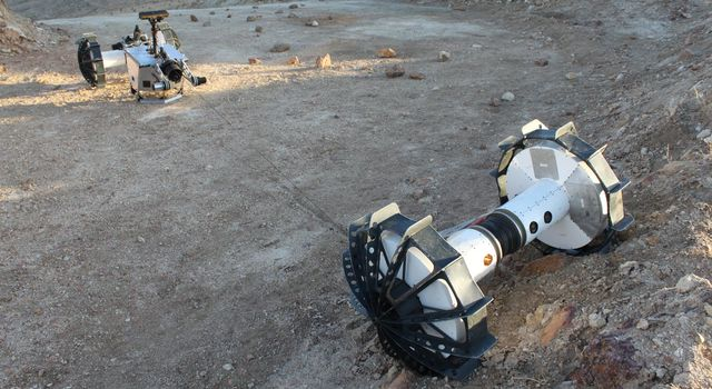 During the same field test, the DuAxel rover separates into two single-axled robots so that one can rappel down a slope too steep for conventional rovers